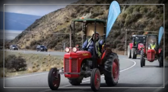 Tractors cross the finish line for Sir Ed's hut.